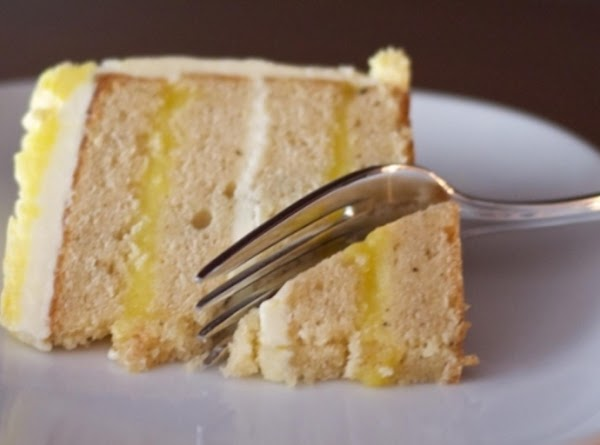 TO ASSEMBLE: Slice both layers of COOLED cake in half, horizontally--to create 4 separate layers...
