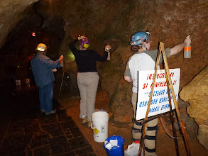 Photo: Bob, Nicole & Heather spraying a peroxide solution in the first hallway near the entrance