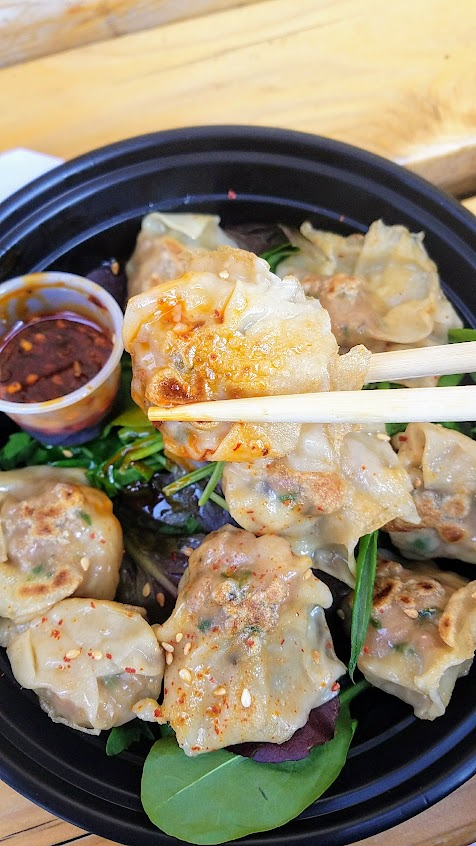 Dumpling Week 2018 - For dumpling week Mama Chow Kitchen offered a pan seared version of their wontons from their standard wonton soup, these are Pork and Shimp dumplings on a bed of baby green salad and served with a spicy dipping sauce.