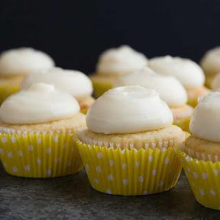 Vanilla Cupcakes with Lemon Cream Cheese Frosting.