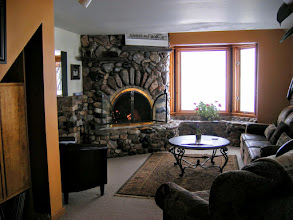Photo: Living Room with wood burning fireplace and Teton View