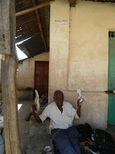 Photo: BBN Member cobbler working with Bangla-Pesahttp://koru.or.ke