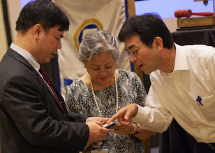 Photo: 22 August 2013 - General Monthly Meeting of FINEX.  (L-R) Bach Nguyen, Conchita Manabat, and Tsutomo Mannari of JACFO