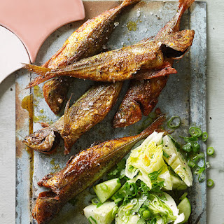 Yellowtail Scad Fish-fry With Cucumber And Iceberg Salad.