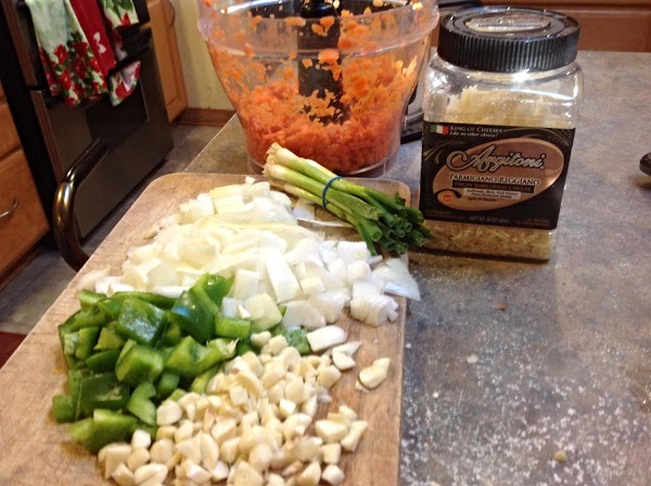 Do a  rough chop of the fresh veggies for pasta. Boil a large...