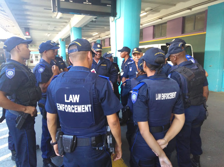 Members of Cape Town's rail enforcement unit meet before going on patrol