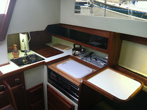 Photo: brand new galley countertop, brand new stainless sink, added custom made collapsable galley table, new origo 5000 two burner stove, pressurized water.