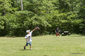 Photo: Playing catch in the field at Lake St. Catherine State Park by Karalyn Mark