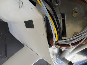 Photo: Detail of the left side electrical conduit.  These go into the left wing and also to all of the engine wiring.