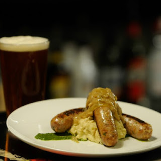 Curry Sausages with Cauliflower Mash.