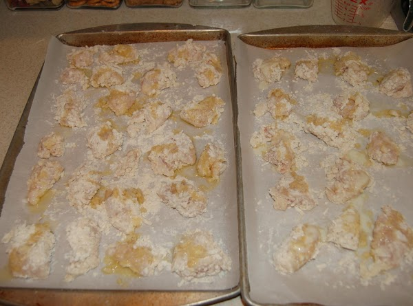 Place chicken pieces on parchment lined baking pan. Drizzle with melted butter.