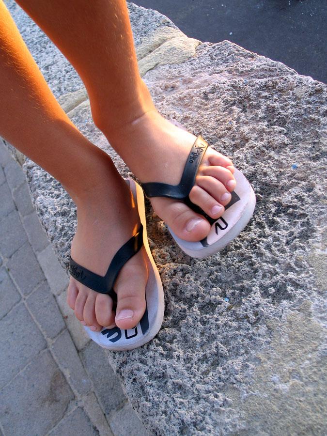 feet of person wearing flip flops