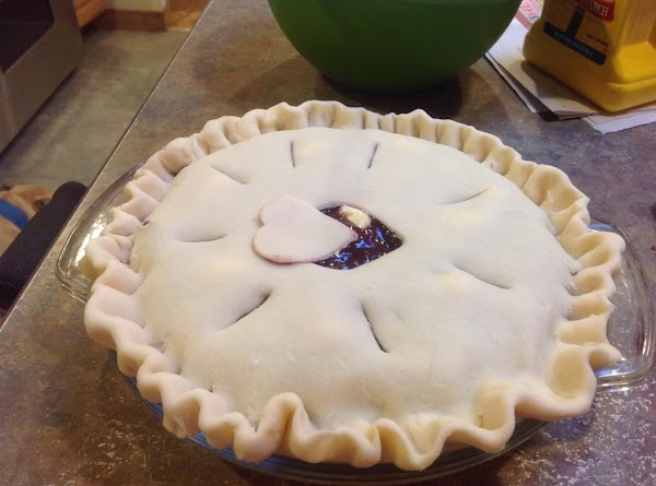Add top crust and seal top crust together with bottom crust. Cut slits into...