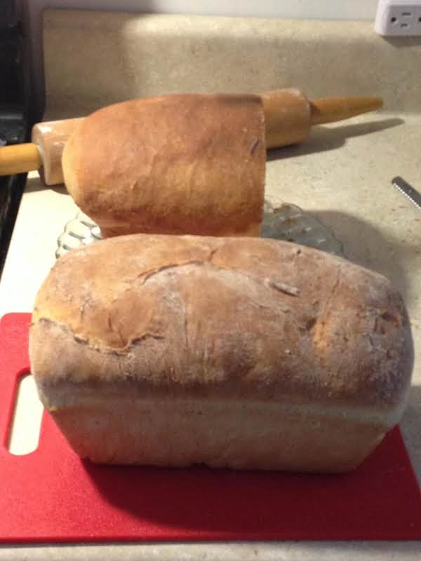 The Half Of Loaf That Is Left..lol..has The Buttered Top..the Whole Loaf In The Forefront Has An Unbuttered Top...your Preference.