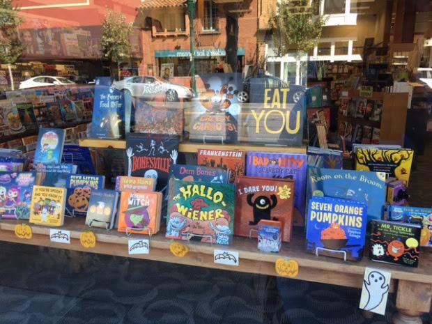 View through window of Halloween books table display