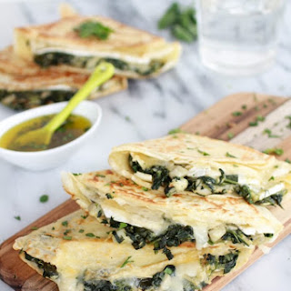 Spinach Artichoke and Brie Crepes with Sweet Honey Sauce.