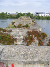 Photo: Here are the remnants of Poissy's old bridge (a bit reminiscent of Avignon's Pont Saint-Bénezet), whose origins go back to the 13th century. In medieval times, the bridge had thirty seven arches and was topped with four windmills. In the 17th century it became a fortified toll bridge, with a drawbridge, and a solid door at each end that opened and closed at specific times. The Seine at Poissy was a rich fishing area, with nets strung between all of the bridge's arches - but only at night, since navigation was a daytime priority. The bridge was permanently destroyed by Allied bombing 26 May 26, 1944, and a temporary one used from 1946 to 1951.