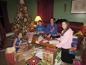 Photo: Olivia, Devin, Lora and Kylee wrapping gifts.
