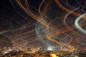 Photo: Not photoshopped. I was experimenting with slow shutter to capture a feeling in the air over Tel Aviv