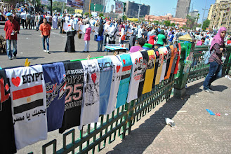Photo: Clothing and various other kinds of memorabilia commemorating the January 25 revolution in Egypt can be found for sale by everywhere in Tahir Square.