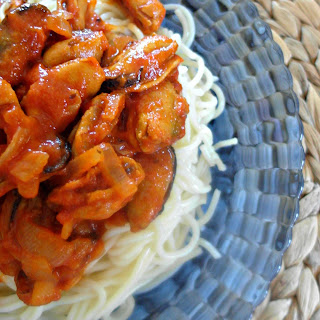 Spaghetti With Mussels Cooked In Tomato Sauce And Ouzo.
