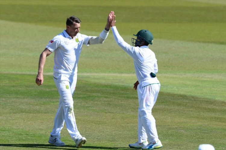Dale Steyn and Temba Bavuma of the Proteas celebrate the wicket of Neil Wagner of New Zealand during day 3 of the 2nd Sunfoil International Test match between South Africa and New Zealand at SuperSport Park on August 29, 2016 in Pretoria,.