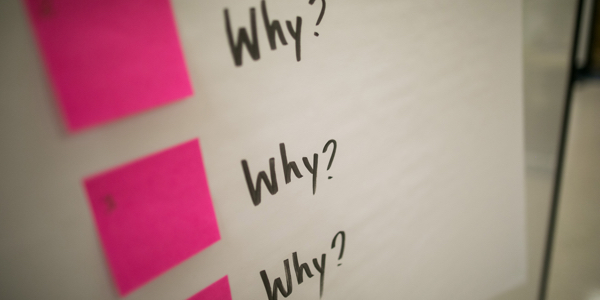 'Why' written on a pad of paper