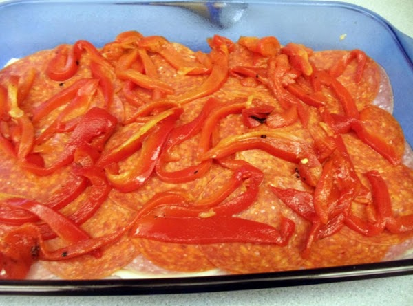 Distribute drained and sliced roasted red peppers over top.