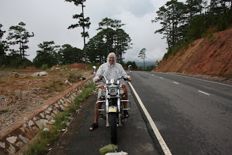 Photo: Year 2  Day 16  -  Rog in his Poncho on our Bike on the Way Back from Dalat