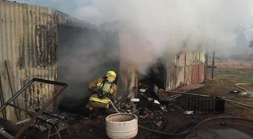A firefighter battles the smoke