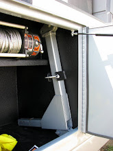 Photo: The winch line riser stores against the wall in the right/front compartment. It is sized to not take up extra space.
