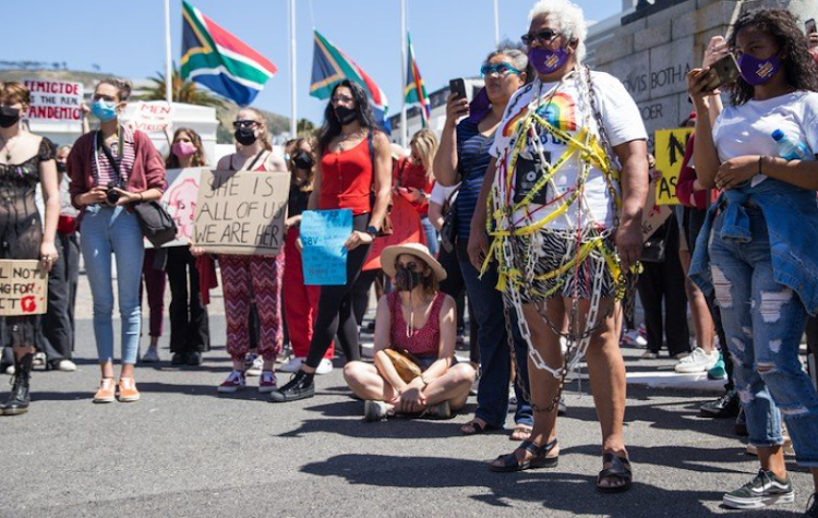 Venetia Orgill, an ambassador for SA women Fight Back, attended the protest wrapped in chains and police tape.
