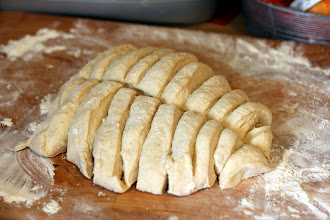 Photo: Slice dough into sections. Then roll out dough in between the board and your hand.