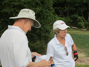 Photo: Bill Day and Nancy Spalding review the line-up for the tournament.