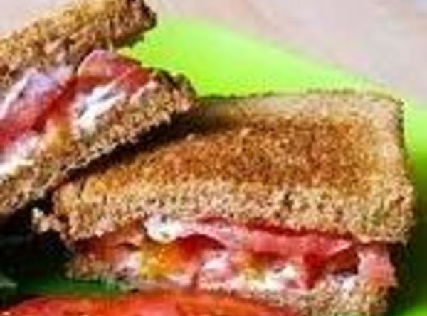 TOMATO SANDWICH: Spread mayonnaise on 2 slices of white bread. Place fresh lettuce leaves...