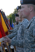 Photo: Soldiers and Airmen compise a color guard representing each battalion and wing in Minnesota during a ceremony held in front of Capitol Building for Minnesota State's Sesquacentennial.