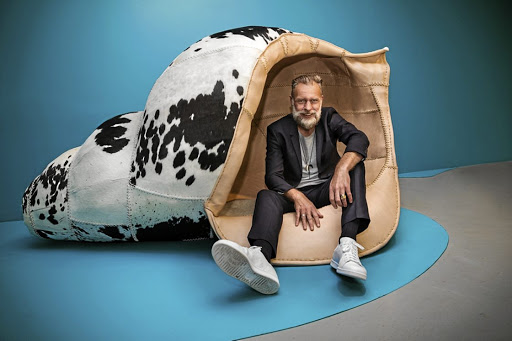 Artist Porky Hefer takes a load off in one of his whimsical seats.