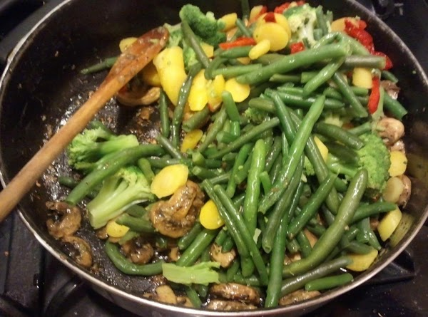 Now gently toss the green beans & carribean vegetables together, then set aside till...