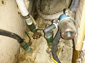 Photo: the dirty chaos that is the head plumbing.  This all must be removed.