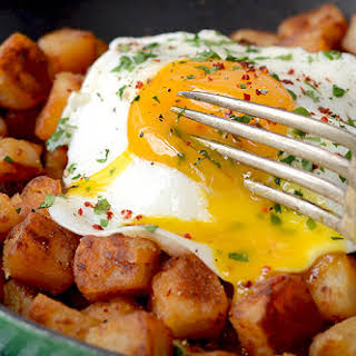 Crispy Aleppo Pepper Breakfast Potatoes with Sunny Side Up Eggs.