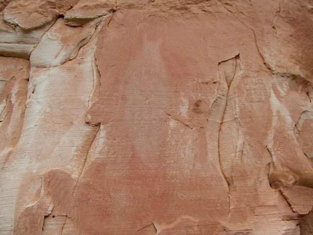 Petroglyphs and a ghostly-white pictograph