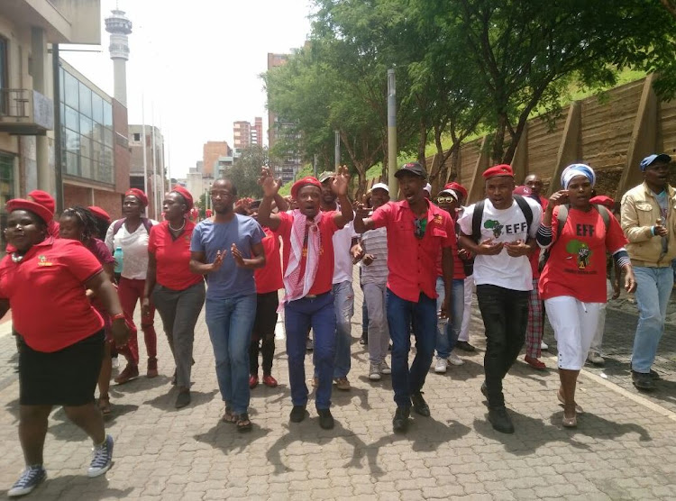 The EFF celebrate their victory outside the Constitutional court.