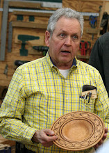 Photo: Bill Autry explains his practice pyrography on the rim of his bowl.