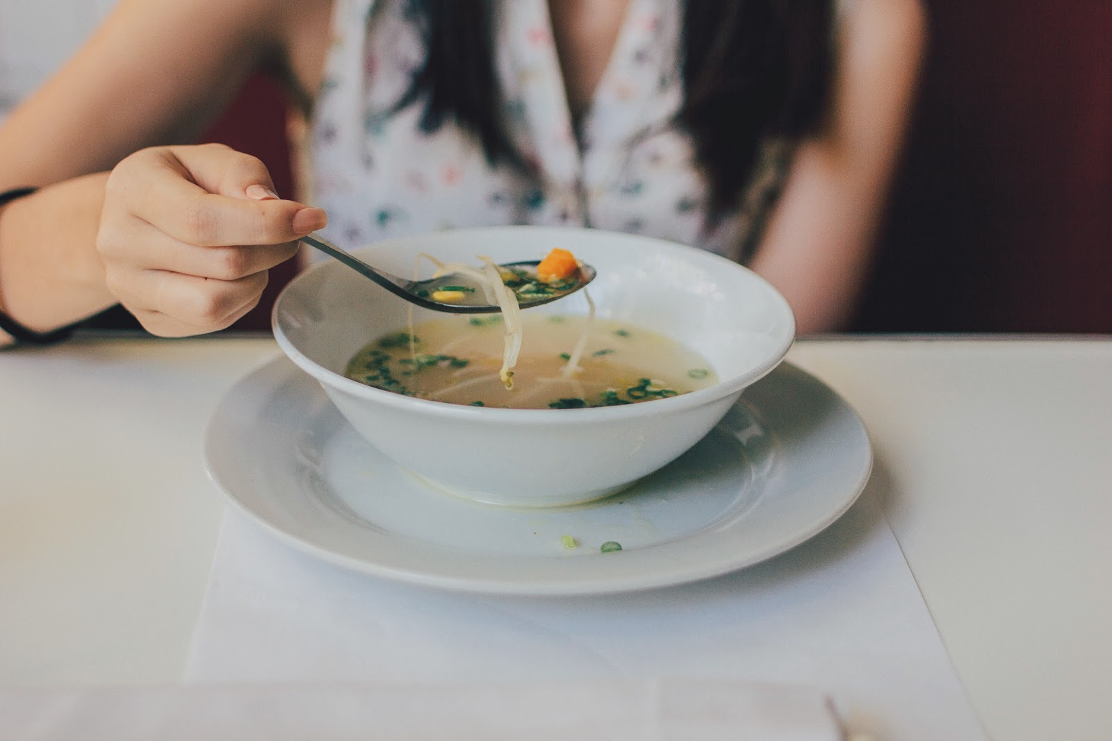 Autoimmune diet: A woman eats soup