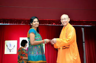 Photo: Asha Prasad Pillai who has done well in A level receiving the Award from Swami Satyalokananda