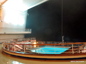 Photo: The Terrace Pool from the Horizon Terrace in the very aft of the ship.  This evening, our first, was foggy, damp and windy.