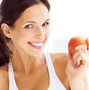 Smiling Lady with White Teeth Holding Apple
