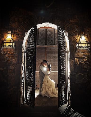 Doorway of Love by Joseph Humphries - Wedding Bride & Groom ( kissing, arch, weddings, wedding, wedding dress, bride and groom, backlighting, rustic )