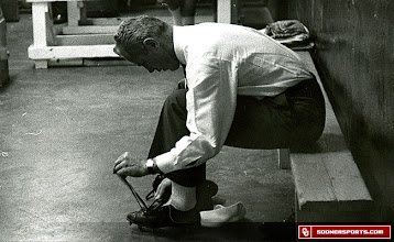 Photo: Wilkinson lacing up his cleats prior to a game.