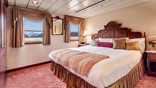 ss-legacy-owners-suite.jpg - The 300-square-foot bedroom of the tastefully decorated Owner's Suite on SS Legacy.
